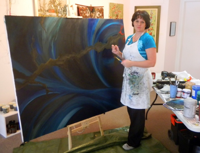 Tracy Mae Chambers starts a painting in Arts Place Gallery